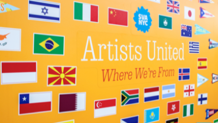 Wall full of small flags that says 'Artists United: Where we're from'