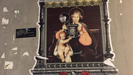 Picture of Baby Jesus and Mary holding an old camera